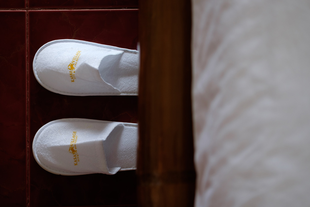 Complimentary slippers are included in the Sea View Deluxe Room